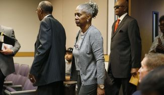 FILE - In this May 7, 2015, file photo, LaVerne Toney, center, arrives in Clark County Family Court in Las Vegas. Less than two weeks after blues legend B.B. King was laid to rest near his birthplace in the Mississippi Delta, a battle over his estate is moving from the headlines to the courthouse in Las Vegas. Attorneys for King's designated executor, Toney, have filed documents in Nevada state court to fend off allegations that King family members were kept away in his dying days, that he was mistreated medically and that his money was siphoned off before he died May 14 at his Las Vegas home at age 89. (AP Photo/John Locher, File)