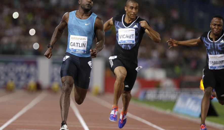 Justin Gatlin, of the United States, left, runs alongside France's Jimmy Vicaut to win  the men's 100m event at the Golden Gala IAAF athletic meeting, in Rome's Olympic stadium, Thursday, June 4, 2015. (AP Photo/Andrew Medichini)