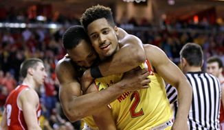 Dez Wells and Melo Trimble (2) led Maryland to a second-place regular season finish and Big Ten Tournament semifinals. (Associated Press) **FILE**