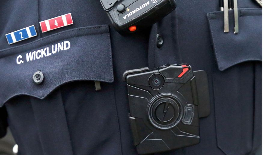 The police department initially sought $5 million for the purchase of 2,400 body cameras in the coming fiscal year, and D.C. Mayor Muriel Bowser suggested making videos from the cameras exempt from all FOIA requests. (Associated Press)