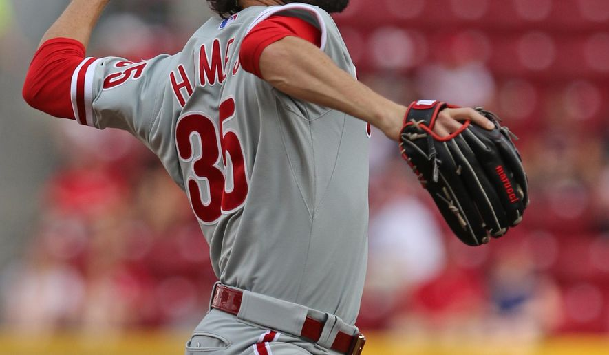 Philadelphia Phillies' starting pitcher Cole Hamels (35) throws against the Cincinnati Reds' during the first inning of their baseball game played Monday, June 8, 2015, in Cincinnati. (AP Photo/Gary Landers)