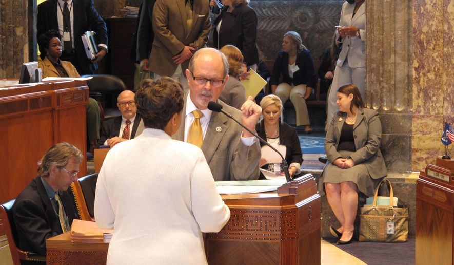 Senate Finance Committee Chairman Jack Donhaue, R-Mandeville, takes questions about next year's $24 billion budget proposal from Sen. Karen Carter Peterson, D-New Orleans, on Monday, June 8, 2015, in Baton Rouge, La. With the legislative session in its final week, the haggling is nearly all about the budget now. (AP Photo/Melinda Deslatte)