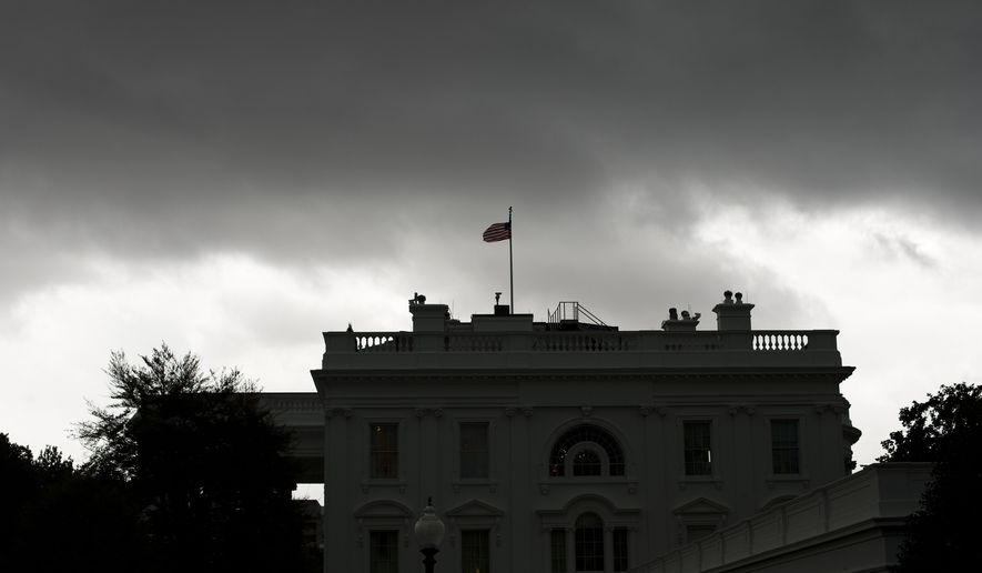 Dark storm clouds are seen over the White House in Washington on Oct. 15, 2014. (Associated Press) **FILE**