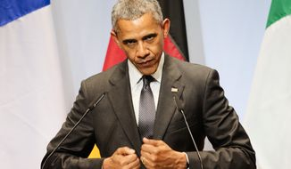 U.S. President Barack Obama speaks during a media conference at the conclusion of the G-7 summit at Schloss Elmau hotel near Garmisch-Partenkirchen, southern Germany, Monday, June 8, 2015. The two-day summit  addressed such issues as climate change, poverty and the fight against terrorism. (AP Photo/Markus Schreiber)