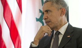 US President Barack Obama pauses as he participates in a bilateral meeting with Iraqi Prime Minister Haider al-Abadi during the G-7 summit in Schloss Elmau hotel near Garmisch-Partenkirchen, southern Germany, Monday, June 8, 2015. (AP Photo/Carolyn Kaster)