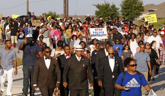 Thousands march Monday, June 8, 2015, toward a community pool during a protest in response to an incident at the pool involving McKinney police officers in McKinney, Texas. (AP Photo/Ron Jenkins)