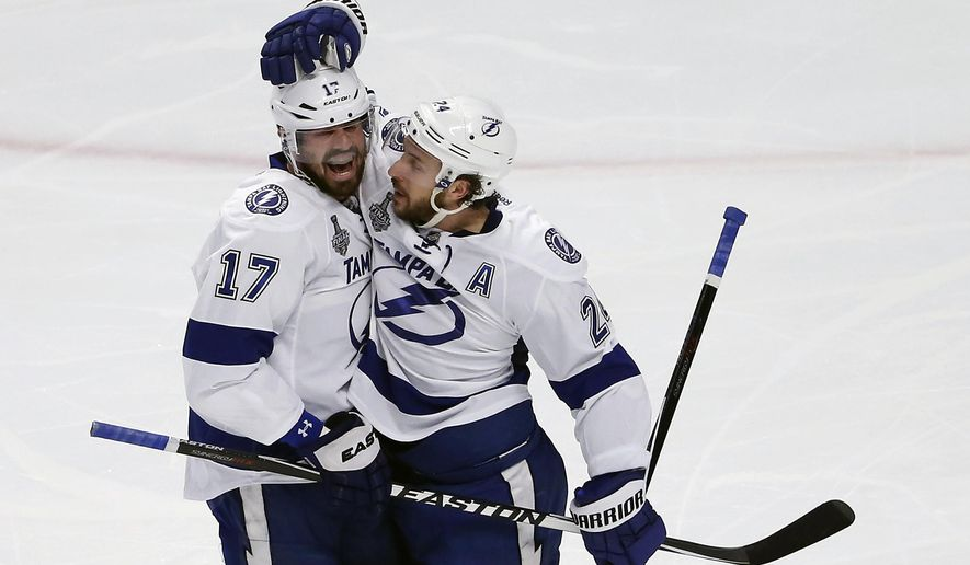 Tampa Bay Lightning's Ryan Callahan (right) is congratulated by teammate Alex Killorn after scoring during the first period Monday in Game 3 of the Stanley Cup Final against the Chicago Blackhawks. (Associated Press)