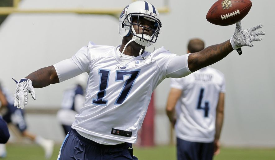 Tennessee Titans wide receiver Dorial Green-Beckham reaches for a pass during an  NFL football organized team activity at the team's training facility, Monday, June 8, 2015, in Nashville, Tenn. An aggravated hamstring has limited the 6-foot-5 wide receiver who is working to reform his image after off-field issues dropped him into the second round of the draft. (AP Photo/Mark Humphrey)