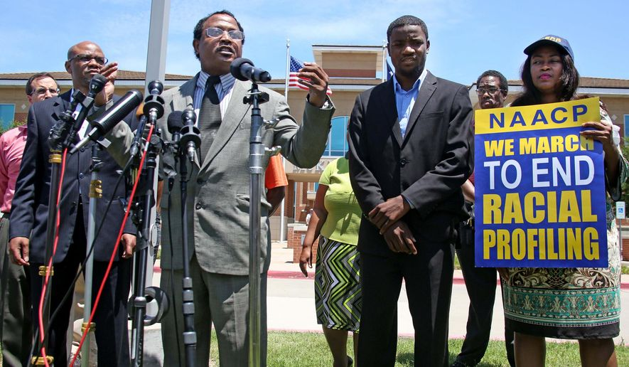Pastor Ronald Wright, middle, speaks during a news conference outside the McKinney Police Department headquarters, Monday, June 8, 2015, in McKinney, Texas. A McKinney police officer has been placed on leave after a video showed him pushing a 14-year-old girl to the ground outside a pool and pointing his gun at other black teens. Also pictured are author David Lee, left, and Pastor Dominique Alexander, second from right. (Louis DeLuca/The Dallas Morning News via AP)