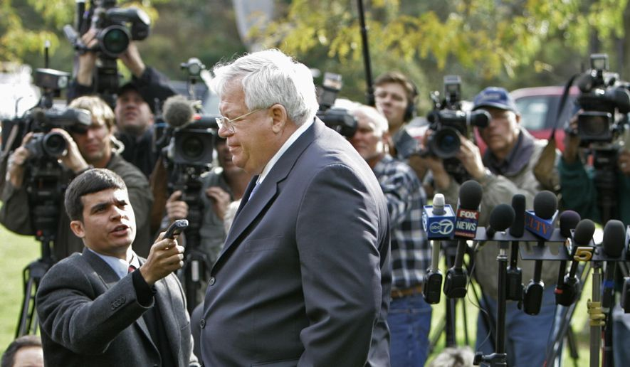 In this Oct. 10, 2006, file photo, then House Speaker, Dennis Hastert walks away from the media after answering questions about ex-Rep. Mark Foley's involvement with former pages at a news conference in Aurora, Ill. The 73-year-old former speaker is scheduled to make his first court appearance federal court Tuesday, June 9, 2015, in Chicago. (AP Photo/M. Spencer Green, File)