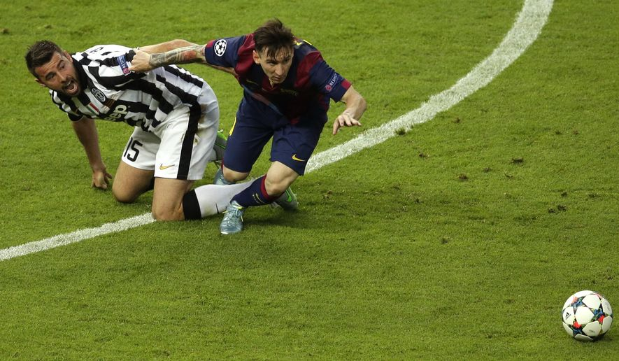 Juventus' Andrea Barzagli fights for the ball against Barcelona's Lionel Messi during the Champions League final soccer match between Juventus Turin and FC Barcelona at the Olympic stadium in Berlin Saturday, June 6, 2015. (AP Photo/Michael Sohn)
