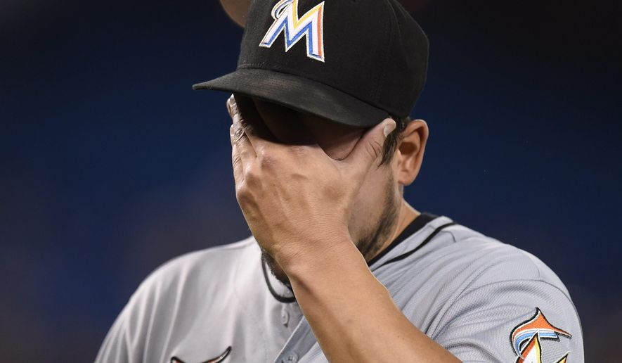 Miami Marlins' starting pitcher Brad Hand is pulled during a baseball game against the Toronto Blue Jays, Monday, June 8, 2015, in Toronto. (Frank Gunn/The Canadian Press via AP) MANDATORY CREDIT