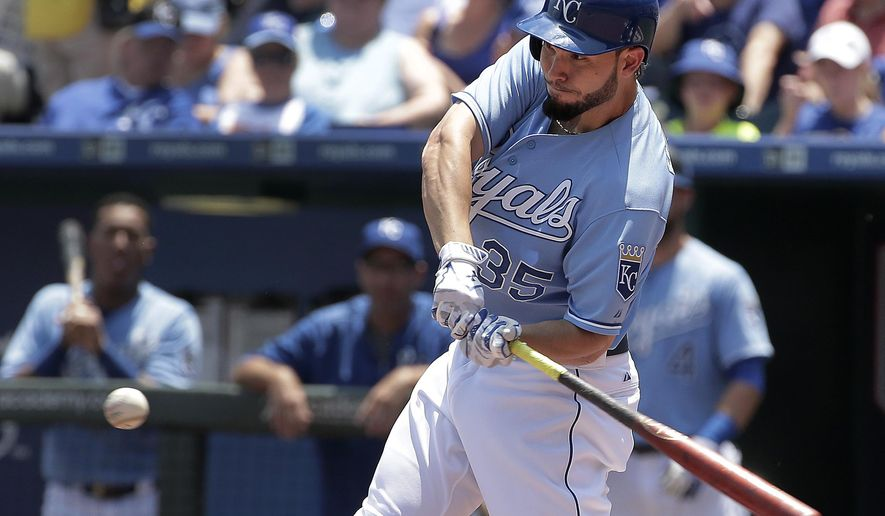 Kansas City Royals' Eric Hosmer hits a sacrifice fly to score Alcides Escobar during the first inning of a baseball game against the Texas Rangers, Sunday, June 7, 2015, in Kansas City, Mo. (AP Photo/Charlie Riedel)