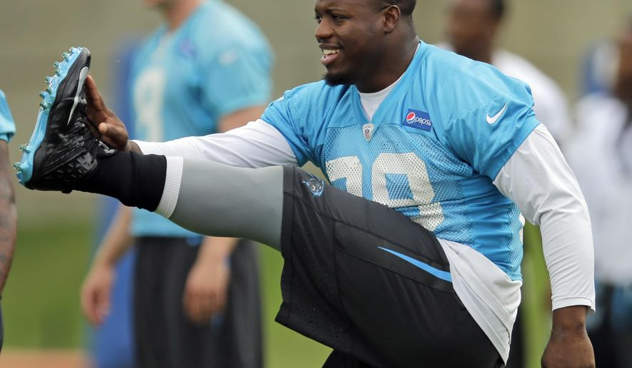Carolina Panthers' Jonathan Stewart stretches during an NFL football organized team activity in Charlotte, N.C., Monday, June 8, 2015. Stewart is the unquestioned No. 1 running back for the Panthers now that DeAngelo Williams is gone. Stewart has always shared duties with Williams throughout his career but for the first time heads into the season at the premier back. (AP Photo/Chuck Burton)