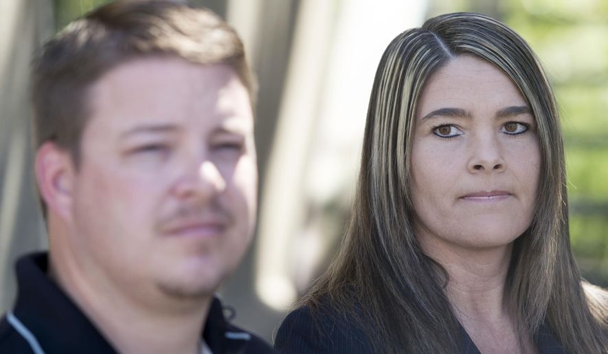 Attorney Lindsay Jarvis, right, and former West Valley City police officer Shaun Cowley answer questions about settlement with West Valley City on Cowley's back pay during a news conference in Sandy, Utah Monday, June 8, 2015. West Valley City has agreed to pay $120,000 to settle with Cowley, who was fired after a fatal shooting during a drug investigation. (Steve Griffin/The Salt Lake Tribune via AP) DESERET NEWS OUT; LOCAL TELEVISION OUT; MAGS OUT