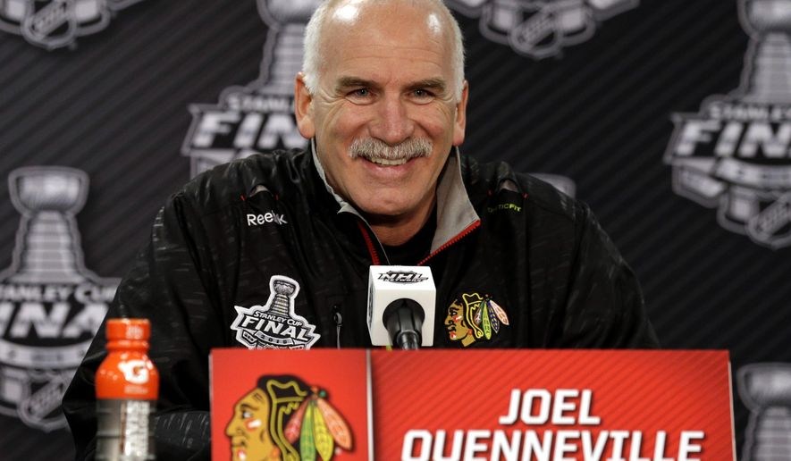 Chicago Blackhawks head coach Joel Quenneville smiles as he talks during a news conference, Sunday, June 7, 2015, in Chicago. The Blackhawks and the Tampa Bay Lightning are tied 1-1 in the NHL hockey Stanley Cup Final after the Tampa Bay Lightning defeated the Chicago Blackhawks 4-3 in Game 2. Game 3 is scheduled for Monday. (AP Photo/Nam Y. Huh)