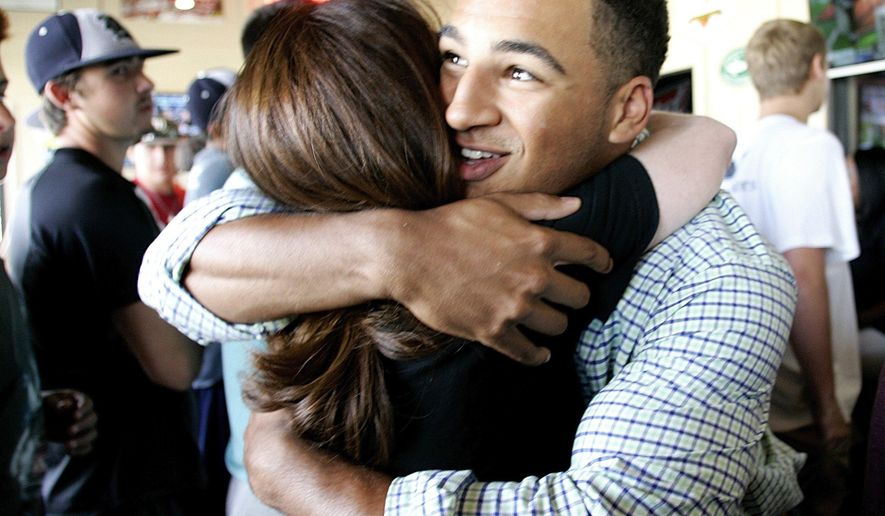 Trent Clark hugs friend Mary Thornton during the Major League Baseball draft viewing at Pluckers in Fort Worth, Texas, Monday night, June 8, 2015. Clark was chosen 15th by the Milwaukee Brewers.     (Bob Booth/The Fort Worth Star-Telegram via AP)  MAGS OUT; (FORT WORTH WEEKLY, 360 WEST); INTERNET OUT; MANDATORY CREDIT
