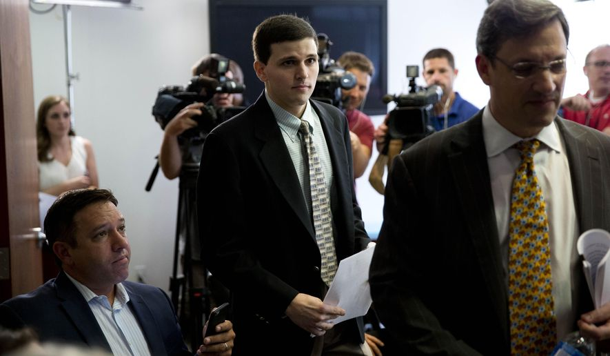 James Vivenzio, center, accompanied by his attorney Aaron J. Frewiald, arrives for news conference Monday, June 8, 2015, in Philadelphia. Vivenzio, a former student who blew the whistle on a Penn State fraternity's secret Facebook page featuring photos of naked women, says the university ignored his complaints about sexual assault, hazing and drug use. Vivenzio says in a lawsuit Monday against the university and the suspended frat that he waited eight months for Penn State to take action before going to police in January.  (AP Photo/Matt Rourke)