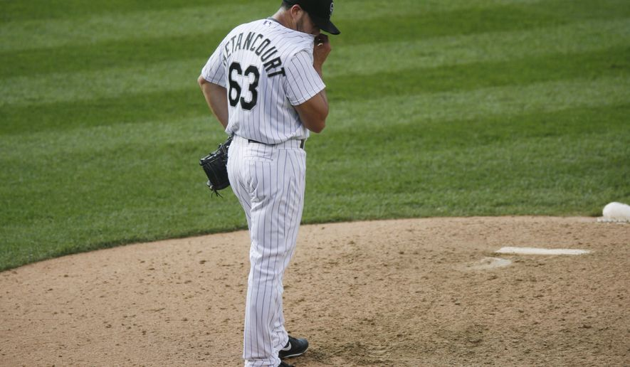 Colorado Rockies relief pitcher Rafael Betancourt reacts after giving up a single to allow in two runs to Miami Marlins' Jeff Baker in the bottom of the ninth inning of a baseball game Saturday, June 6, 2015, in Denver. Colorado won 10-5. (AP Photo/David Zalubowski)