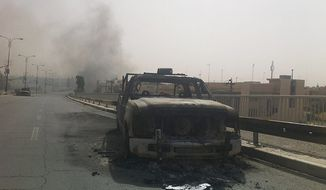 Islamic State fighters left a path of death and destruction as they blazed their way through northern Iraq last year and captured two key Sunni-dominated cities. Some analysts predict they will try to make further incursions during Ramadan, including in Baghdad. (Associated Press)
