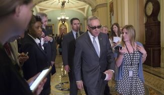 Senate Minority Leader Harry Reid of Nevada walks to a news conference on Capitol Hill in Washington on June 9, 2015, following a Senate policy luncheon. (Associated Press) **FILE**