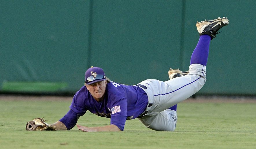 LSU center fielder Andrew Stevenson dives to catch the ball for the third out during the bottom of the first inning of an NCAA college baseball tournament regional game, Saturday, June 1, 2013, in Baton Rouge, La. (AP Photo/Bill Feig)