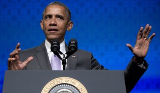 """President Barack Obama gestures as he speaks to the Catholic Hospital Association Conference at the Washington Marriott Wardman Park in Washington, Tuesday, June 9, 2015.  Obama declared that his 5-year-old health care law is firmly established as the """"reality"""" of health care in America, even as he awaits a Supreme Court ruling that could undermine it. (AP Photo/Carolyn Kaster)"""