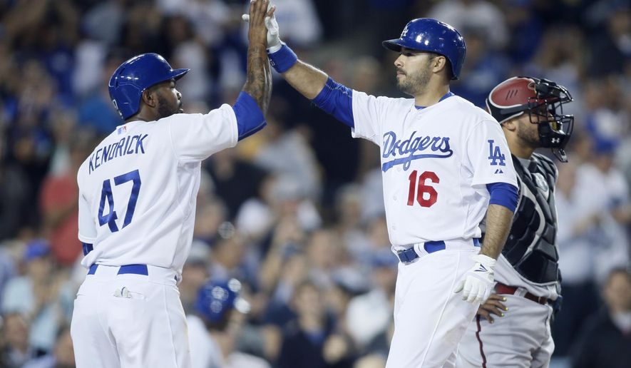Los Angeles Dodgers' Andre Ethier celebrates his three run home run with Howie Kendrick, left, past Arizona Diamondbacks catcher Welington Castillo, right, after hitting in Kendrick and Yasmani Grandal, not pictured, during the fifth inning of a baseball game, Monday, June 8, 2015, in Los Angeles. (AP Photo/Danny Moloshok)