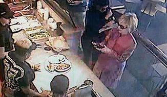 From Twitter: Spotted: @Hillary Clinton ordering Chipotle in Ohio, security footage (and Clinton aide) confirms.   Huma Abedin also pictured.