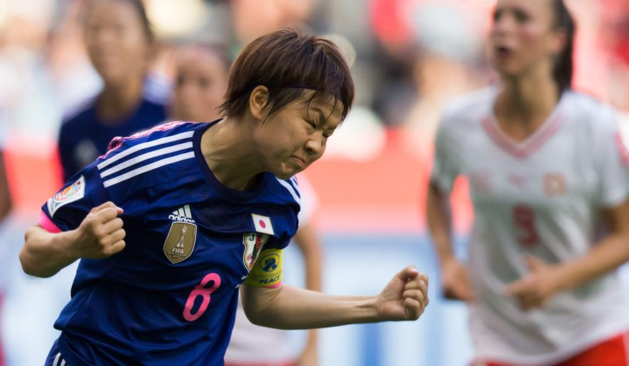 Japan's Aya Miyama (8) celebrates her penalty kick goal against Switzerland during first half FIFA Women's World Cup soccer action in Vancouver, British Columbia, on Monday June 8, 2015. (Darryl Dyck(/The Canadian Press via AP) MANDATORY CREDIT