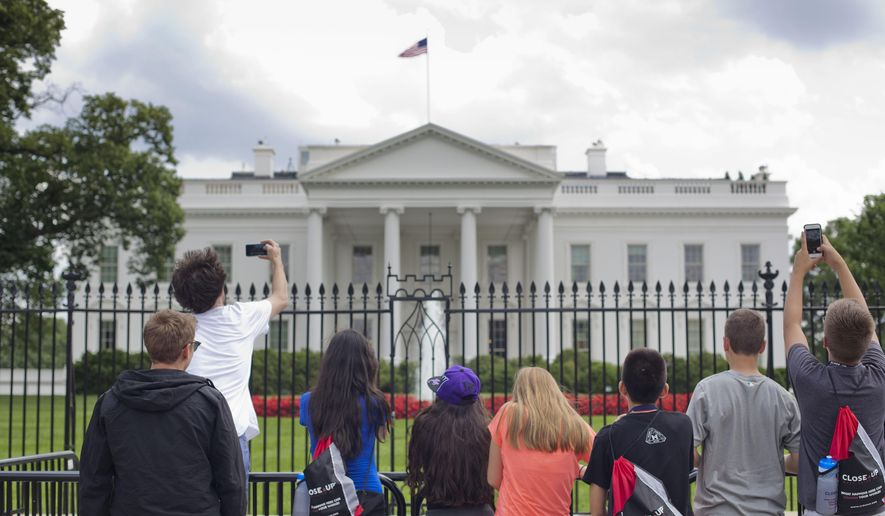 People use their cellphones to take pictures of the White House in Washington, Tuesday, June 9, 2015, after pedestrian access to area was reopened. (AP Photo/Pablo Martinez Monsivais)