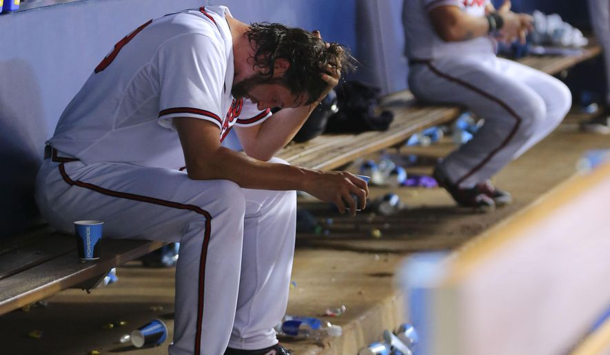 Atlanta Braves relief pitcher Jason Grilli sits on the bench after blowing a lead in the ninth inning of baseball game against the San Diego Padres  Monday, June 8, 2015, in Atlanta. San Diego won 5-3 in 11 innings. (AP Photo/John BAzemore)