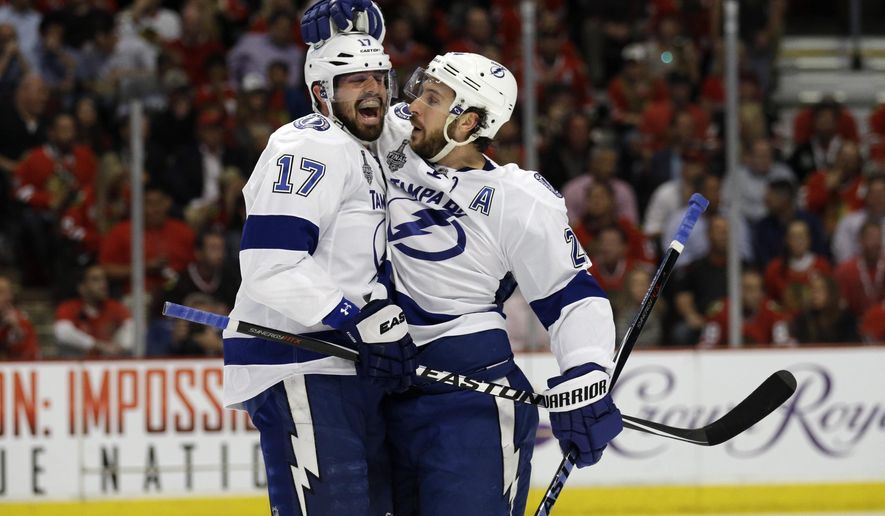 Tampa Bay Lightning's Ryan Callahan, right, is congratulated by teammate Alex Killorn after scoring during the first period of Game 3 of the Stanley Cup Finals against the Chicago Blackhawks Monday, June 8, 2015, in Chicago.  (AP Photo/Nam Y. Huh)