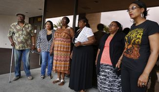 FILE - In this May 21, 2015 file photo, Willie King, from left, Tanya Deckard, Patty King, Karen Williams, Barbara King Winfree and Rita Washington stand outside of a funeral home after a private family viewing of blues musician B.B. King, in Las Vegas. Four of B.B. King's daughters of are raising the possibility that a second will exists, and are again accusing the blues legend's longtime business manager, LaVerne Toney, of stealing his wealth and endangering his health in the days before he died. Probate court documents filed Tuesday, June 9, 2015, in Las Vegas by a lawyer for King,  Williams, Washington and Winfree stop short of previous allegations that Toney and the another aide poisoned B.B. King.  (AP Photo/John Locher, File)