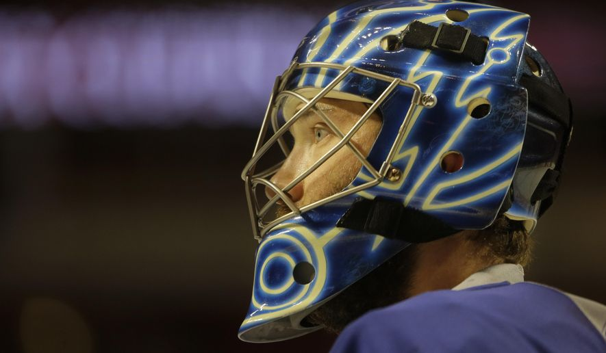 Tampa Bay Lightning goalie Ben Bishop watches during a morning skate at the United Center, Wednesday, June 10, 2015, in Chicago. Game 4 of the NHL hockey Stanley Cup Final is later in the day. (Dirk Shadd/The Tampa Bay Times via AP)  TAMPA OUT; CITRUS COUNTY OUT; PORT CHARLOTTE OUT; BROOKSVILLE HERNANDO TODAY OUT