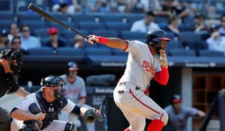 The Nationals' Denard Span hits an RBI single in the 11th inning to allow Tyler Moore to score the game-winning run in a 5-4 victory against the Yankees Wednesday. (Associated Press)