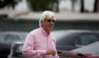Bob Baffert, the trainer for American Pharoah, is taking calls for the Triple Crown winner's next race. (Associated Press)