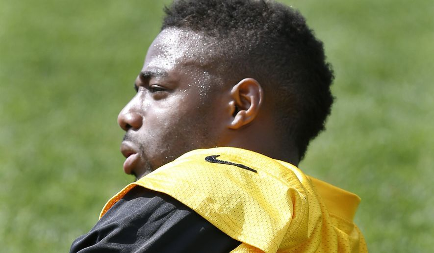 In this May 28, 2015, file photo, Pittsburgh Steelers cornerback William Gay (22) stretches before participating in organized team activity in Pittsburgh. Following the retirement of Ike Taylor and Troy Polamalu, Gay finds himself as the veteran voice of reason in a secondary in the midst of a youth movement. (AP Photo/Keith Srakocic, File)