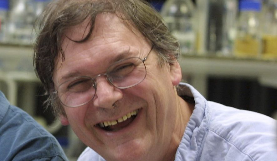 """A Monday Oct. 8, 2001 photo from files of Dr. Tim Hunt, winner of the Nobel Prize for Medicine, in a laboratory in London. The Nobel Prize-winning British scientist has apologized Wednesday, June 10, 2015, for saying the """"trouble with girls"""" working in science labs is that it leads to romantic entanglements and harms science. Tim Hunt made the comments at the World Conference of Science Journalists in South Korea, according to audience members. (AP Photo/Alastair Grant, File)"""