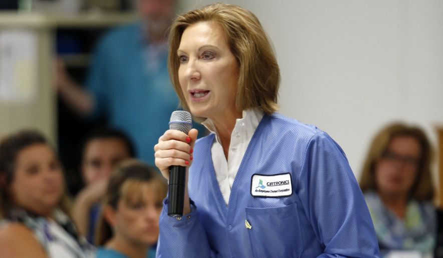 Republican presidential candidate. former Hewlett-Packard chief executive Carly Fiorina speaks with employees  of Cirtronics, Wednesday, June 10, 2015, in Milford, N.H. Fiorina is campaigning in the nation's earliest presidential primary sate. (AP Photo/Jim Cole)