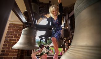 Paulette Vaughan Porter-Stransky, right, helps ring the bell at Sweet Briar College in Amherst, Va., on  Tuesday, June 9, 2015. The Supreme Court of Virginia has tapped the brakes on Sweet Briar College's planned closure, concluding that the debate on the demise of the 114-year-old women's college is far from over. (Autumn Parry/News & Daily Advance via AP)