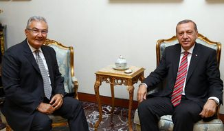 Deniz Baykal, former leader of the main opposition Republican People's Party, left, and President Recep Tayyip Erdogan sit before a meeting in Ankara, Turkey, Wednesday, June 10, 2015. Opposition parties are likely to demand limits on President Recep Tayyip Erdogan's role in Turkey's next government, complicating coalition talks as the ruling party sought ways Tuesday to remain in power. Prime Minister Ahmet Davutoglu was to meet with Erdogan later Tuesday after their Justice and Development Party, or AKP, lost its parliamentary majority in Sunday's vote. (AP Photo/Presidential Press Service, Pool)