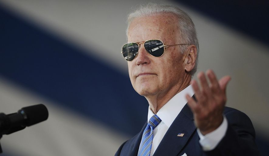 In this May 17, 2015, file photo, Vice President Joe Biden gestures after donning a pair of sunglasses as he delivers the Class Day Address at Yale University in New Haven, Conn. (AP Photo/Jessica Hill, File)