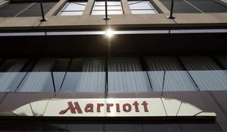 This July 9, 2008, file photo, shows the exterior of the Marriott Hotel in San Francisco. (AP Photo/Paul Sakuma, File)