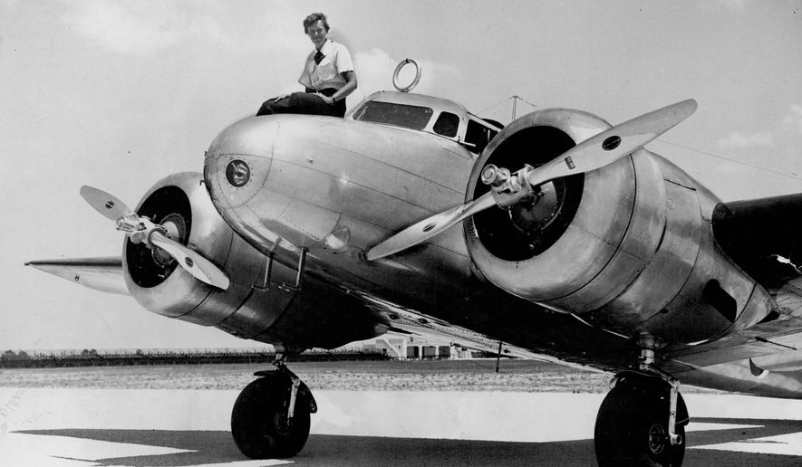 ADVANCE FOR USE SUNDAY, JUNE 14, 2014 AND THEREAFTER - This 1937 photo shows Amelia Earhart before takeoff in Miami for an attempted round-the-world flight. Earhart and her navigator, Fred Noonan, disappeared in the South Pacific in July 1937, while on one of the last legs of that journey. (The Miami Herald via AP)