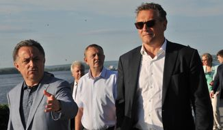 FIFA Secretary General Jerome Valcke, right, and Russian Sports Minister Vitaly Mutko, left, walk along an embankment of Volga river in Samara, Russia, Tuesday, June 9, 2015. Valcke came to attend a 2018 World Cup board meeting. (AP Photo)