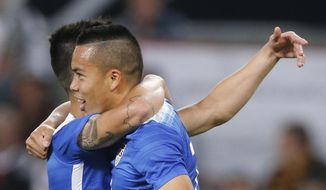 United States' Bobby Woods celebrates after scoring his side's second goal during the soccer friendly match between Germany and the United States in Cologne, western Germany, Wednesday, June 10, 2015. (AP Photo/Frank Augstein)