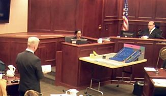In this image made from a video, Gargi Datta, a former girlfriend of Colorado theater shooter James Holmes, is questioned by District Attorney George Brauchcer, during a trail for Holmes, Wednesday, June 10, 2015, in Centennial, Colo. Datta said Wednesday that she met Holmes in 2011 and that they went to a horror film festival on their first date. Holmes pleaded not guilty by reason of insanity in the July 2012 shooting at a suburban Denver movie theater that killed 12 people and injured 70. (Colorado Judicial Department via AP, Pool)