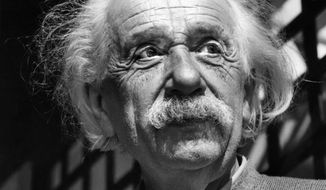 FILE - This June, 1954,  file photo shows renowned physicist Albert Einstein in Princeton, N.J. Einstein was a father who worried his son wasn't taking his geometry studies seriously enough, and that he was indebted to a favorite uncle for giving him a toy steam engine when he was a boy, launching a lifelong interest in science. He also believed the infidelity of a friend's spouse was no big deal. These and other reflections, including personal opinions on God and politics, are contained in 27 letters being offered by a private collector at auction this week. (AP Photo, File)