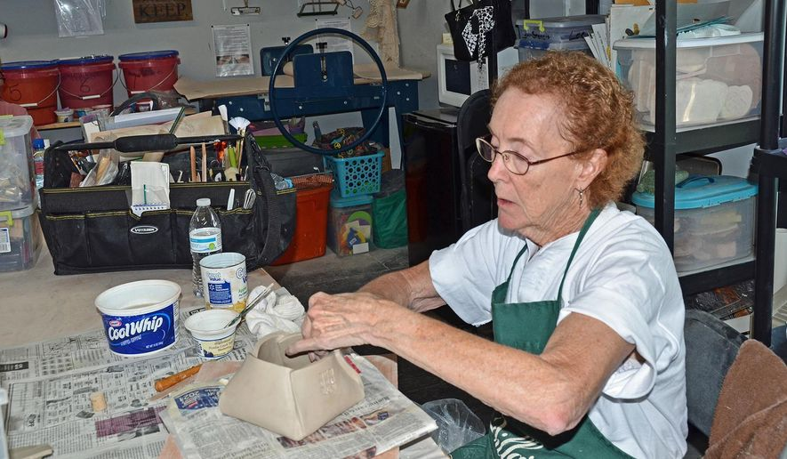 ADVANCED FOR RELEASE MONDAY, JUNE 15, 2015 Linda Parks works on a pottery project in Southport's Earth to Fire pottery studio. (Carolyn Bowers/The Star-News via AP)